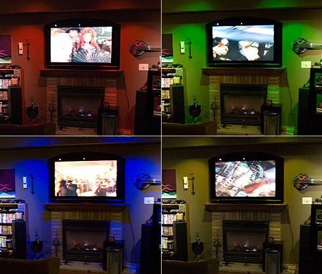 The color effects are clearly visible and vibrant. In this application, the lamps are used to accent the video wall.