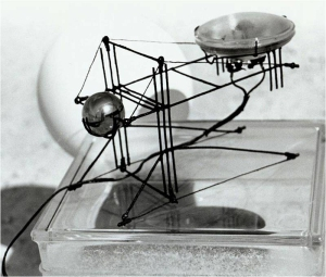 This simple bridge design was created using building and armature wire, a PAR36 halogen lamp, and a ball bearing counter weight.