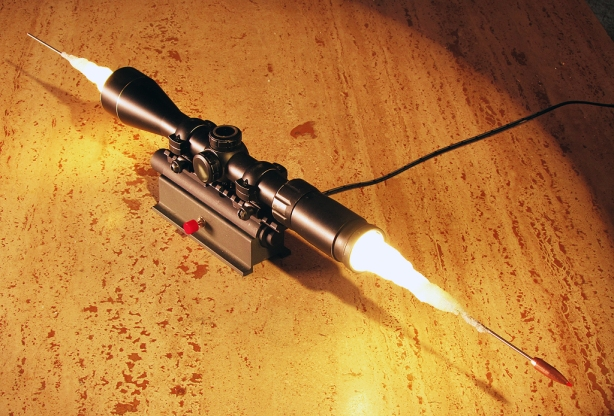 The optics of a bullet passing through a scope are compelling, and invisible to us without high speed photography.